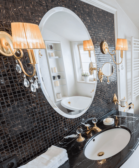 Glamorous modern bathroom sink with decorative accent tiles