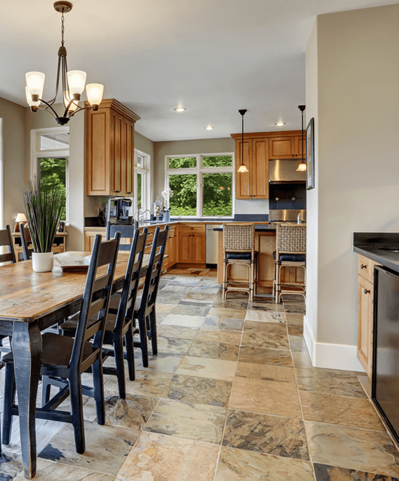 Modern kitchen with natural stone flooring