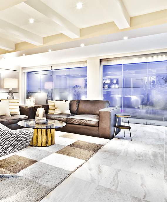 Modern looking living room with white flooring tiles