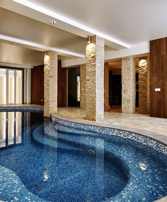 Indoor pool and spa with porcelain tile
