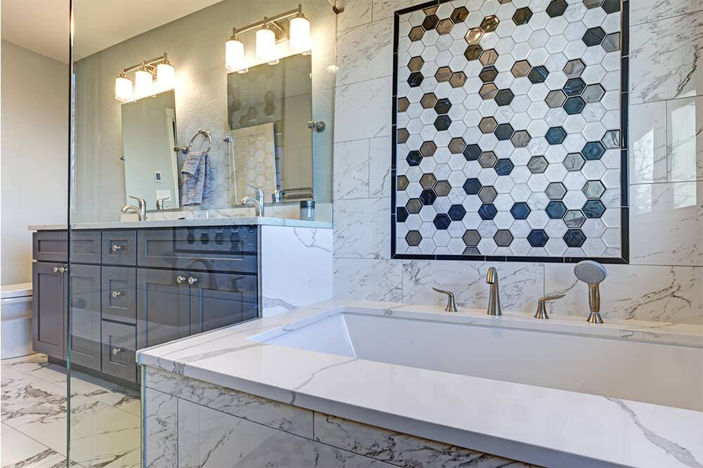 Walk in shower with mosaic accent