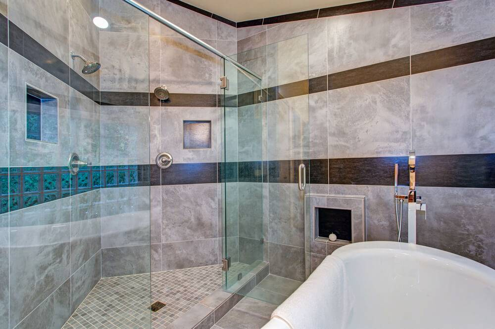 Walk in shower with tiles that look like marble